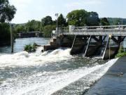 Busy sluices at Hambleden Weir, River Thames, England.