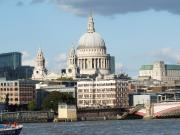 Beautiful view of St. Pauls Cathedral next to The River Thames in London, England.