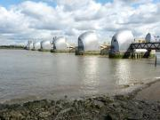 The Thames Barrier going across the River Thames in London.