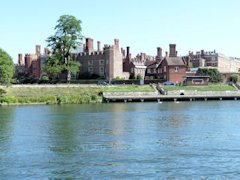 Hampton Court Palace buildings seen from The River Thames.