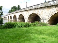 The beautiful old multi arched Maidenhead Bridge over The Thames in England.