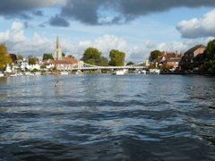 View of Marlow Church and Bridge from The River Thames, England.