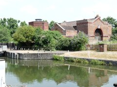 Old River Thames waterworks buildings at Romney Lock, England.